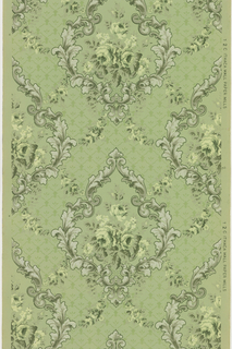 Large medallions made of foliate scrolls with a bouquet of yellow flowers in the center, connected by floral swag and vining. The background has a treillage pattern. Ground is green. printed in greens, mica white, grey, and yellow. 