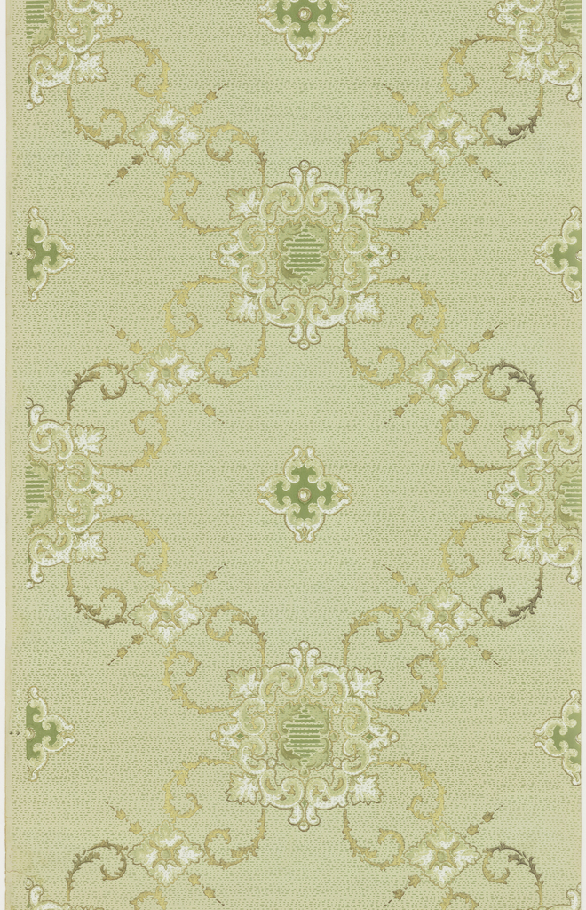 Grid or trellis pattern composed of foliate scrolls and foliate bosses or medallions. A quatrefoil motif is centered in each grid. Printed in green, white, taupe, and metallic gold on tick-mark patterned taupe background.
