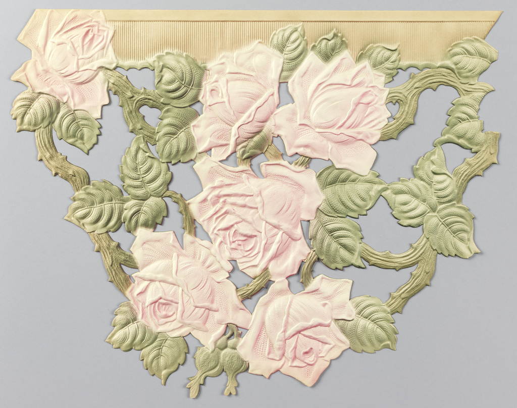 Cluster of pink roses on green leafy vines, suspended from tan architectural molding.