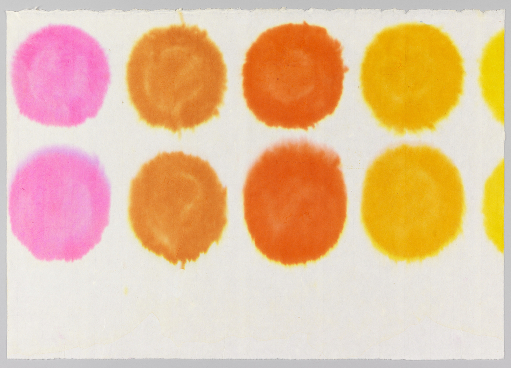 Large dots in two rows running the length of the paper. In pink, two shades of orange, and yellow.