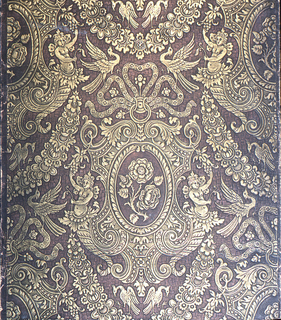 Imitation leather. Motifs of moss rose, nymphs, phoenix, and ribbon. Printed in gold on a copper-brown ground.