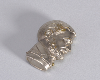 In the shape of Ulysses S. Grant's head in profile, with  4-star epaulet at shoulder, identical on reverse. Lid, hinged on side, flips opens at bottom when small button at neck is depressed. Striker on bottom of lid.