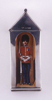 In the form of a sentry box, the body rectangular, the roof (lid) triangular, featuring polychrome enamel decoration of a royal guardsman standing in doorway at attention; he wears full uniform including belted red jacket, black trousers, tall black bearskin hat and holds bayonet at his side. Lid hinged on upper left side. Striker on bottom.