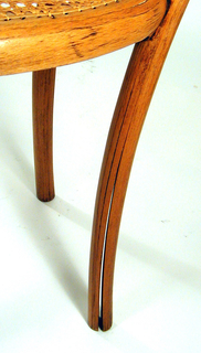 """Curvilinear, bentwood side chair with curved front legs, straight rear legs; roughly square shaped caned seat, and curving back with sinuous, """"heart""""-shaped bentwood elements."""