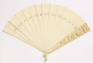 Brisé fan of plain ivory sticks except for the right guard which is carved with four chamois in high relief in a rocky and wooded setting.