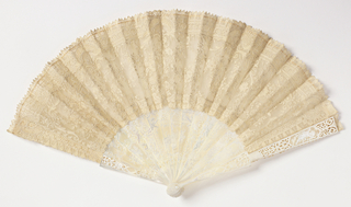 Linen Alençon lace leaf with a different thread used for outlining the design. Mother-of-pearl sticks, carved and pierced with lattice pattern and baskets of flowers. Each guard with a single cupid.   Cardboard case covered, padded and lined with white silk satin. Inside, shaped to fit fan.