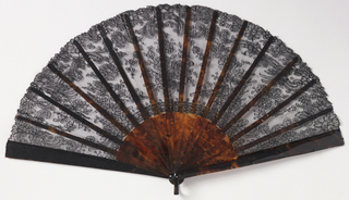 "Pleated fan. Black chantilly lace leaf. Brown tortoise shell sticks.  Black cardboard box with black satin top marked ""Tiffany & Co."""