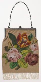 Rectangular bag edged at bottom with beaded fringe and closed at top with a silver frame and chain handle. Naturalistic floral spray on each side.