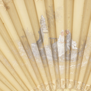 Pleated fan. Silk leaf trimmed with lace and painted with garden scene. Carved and drilled bone sticks.
