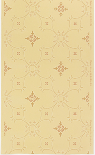 Quatrefoil shapes having the appearance of embroidered stitching with fill of stylized floral motif. Four-petaled floral motif centered in void between quatrefoils. Printed in terra cotta and tan on lighter tan ground.