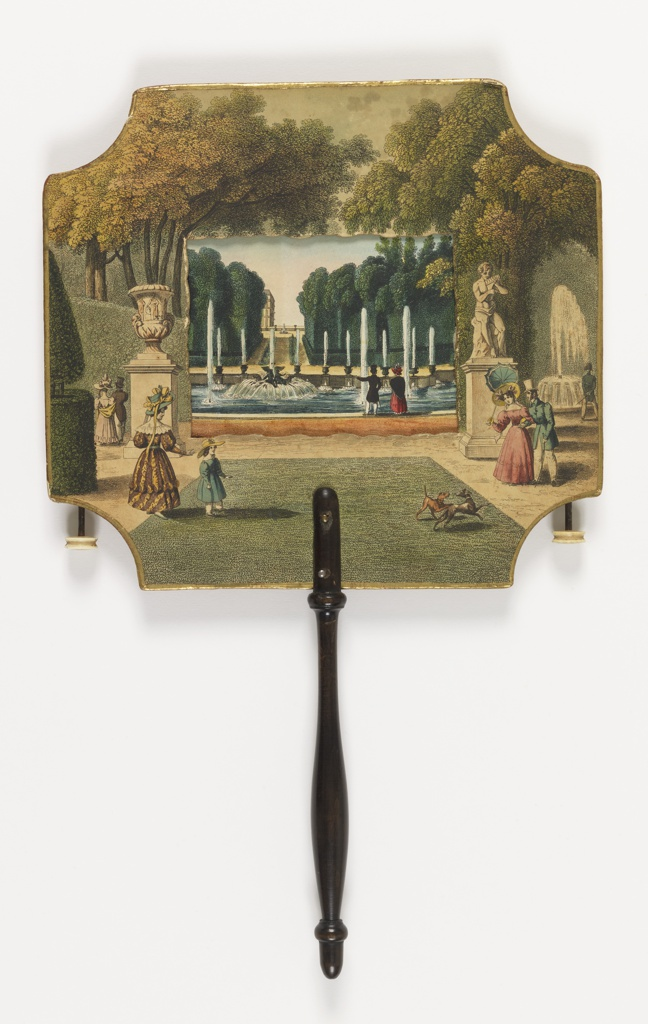A square handscreen with semi-circles cut away in each corner, and a black turned wood handle. The stiff outer area acts as a frame for a thin paper center, which contains seven views of a park, which can be rolled through the frame by means of ivory spindles on either side. By holding the handscreen up to the light, the scenes appear illuminated.