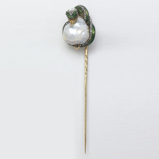 Gold stick pin topped by green-enameled serpent surrounding a baroque pearl.