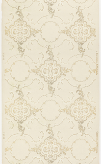 In the Rococo style, circular scrolling medallions containing a quatrefoil in the center, linked to a more circular motif containing a wreath of scrolls in the center. Printed in metallic gold and white mica on light tan ground.
