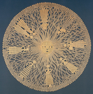 Circular hanging with the face of the sun in the center; female figures in long skirts are arranged around the circle, with waving lines filling the spaces between.