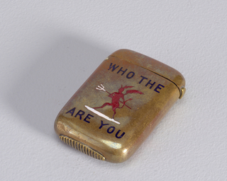 "Rectangular, with curved corners and sides, the front inscribed with the word/picture rebus ""Who The [Devil] Are You"", the text enameled in dark blue, the devil in red, he holds red handled pitchfork, the prongs of which are white, devil stands on white ground. Reverse undecorated. Lid hinged on side. Striker on bottom."