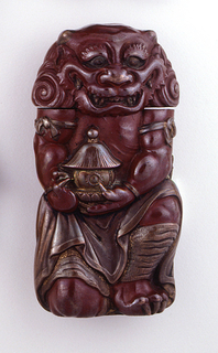 In the form of the demon Oni, with small upright horns, curly hair, broad  nose, wide, toothy grin, clawed fingers and toes, holding lantern; body rust-red in color, with facial features, lantern, garments and claws in copper. Head hinged at back, flips open as lid. Striker on bottom.