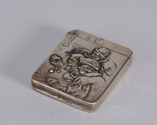 Rectangular, rounded corners, featuring raised decoration of 3 men in tavern setting, possibly 17th century, seated at table and appearing to be throwing dice. Lid hinged on side. Striker in recess on bottom. Monogram on reverse. Lid hinged on side. Striker on bottom.