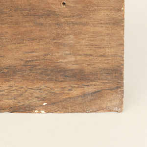carved scrolls in a rectangular, moulded piece of teakwood with stamped number on reverse