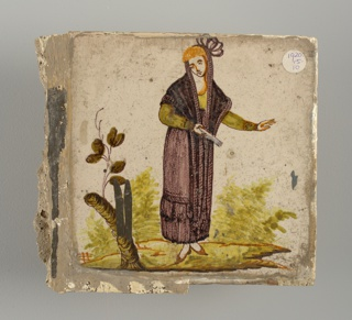 Woman in green blouse, manganese skirt and long shawl, laid over her head. A tree trunk with a few leaves at the left.