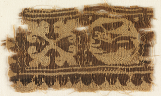 Woven fragment of dark purple wool and undyed linen. At left, an abstracted  four-point flower; at right, an animal within a roundel. Border at top and bottom. One brown weft carried at a time; two undyed linen wefts carried at a time.