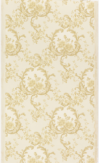 Floral bouquet enclosed within a foliate scroll medallion, trellis fill near bottom. Medallions are arranged in diagonal format. Printed in white mica and tan on lighter tan ground.