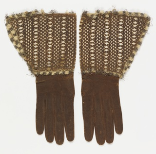 Leather gloves with gauntlet cuffs of cut leather in a lace-like pattern. Lined with brown silk and edged with fringe.
