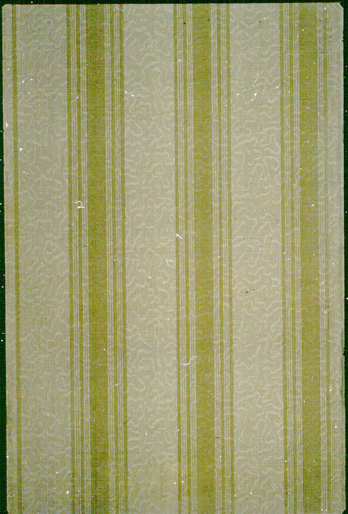 Over-all vermicelli pattern created by cross-hatch lines, overprinted by broad vertical striped ribbons. Printed in beige, ochre and brown.