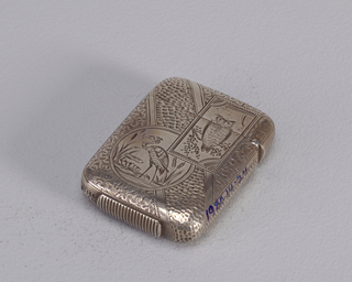 Rectangular, rounded corners, with incised decoration in the aesthetic style: rectangular reserve in upper right corner features owl on branch, same rectangular reserve overlaps circular reserve on lower left, which features heron standing among water lilies and cat tails, all set against background of alternating narrow and wide diagonal bands, the wide bands decorated with fine, alternating stippled and swirling lines. Reverse features on upper left empty reserve shaped like a parallelogram with small fan motif in lower left corner, it overlaps circular reserve on lower right with perching birds ornament, all decoration on same ground of alternating bands as front. Lid hinged on side. Lozenge shaped striker on bottom.