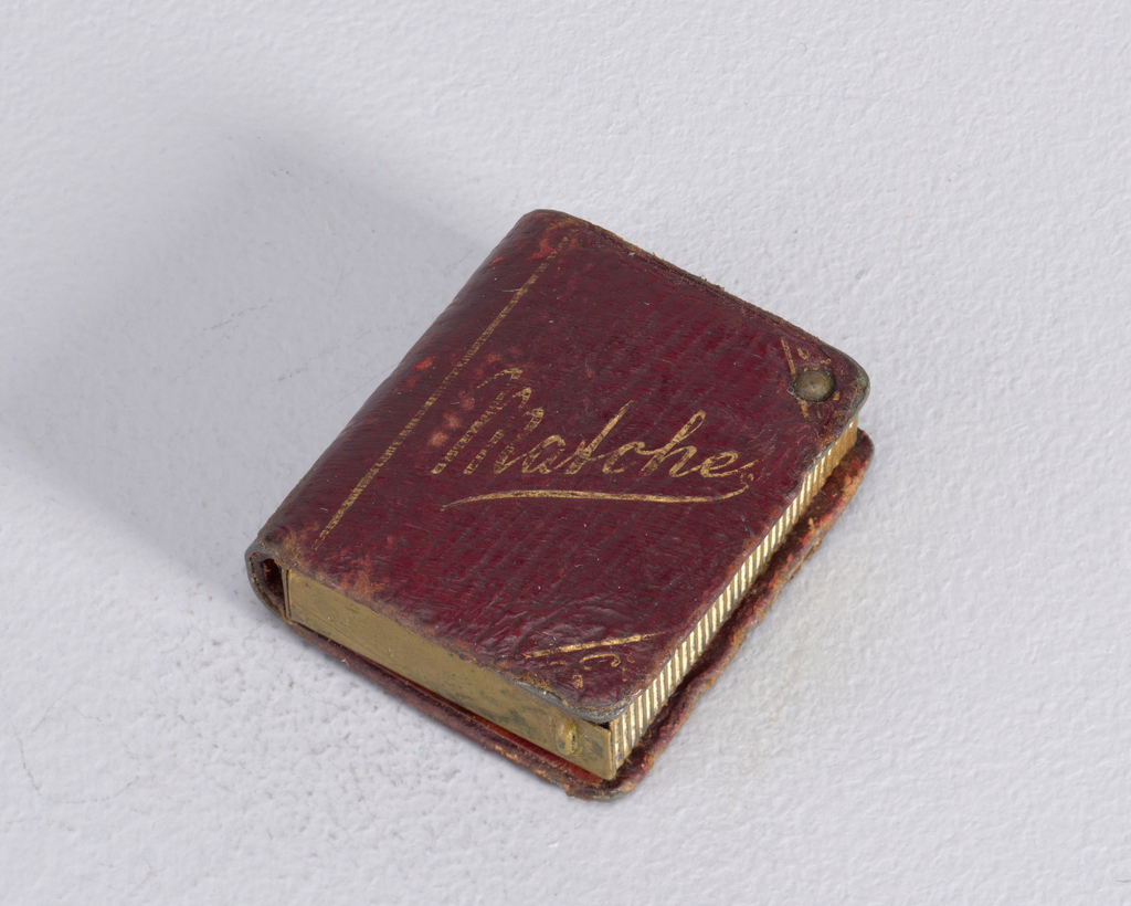 """A dark wood colored square matchsafe. In gold on the front says """"Matches"""" in cursive lettering."""