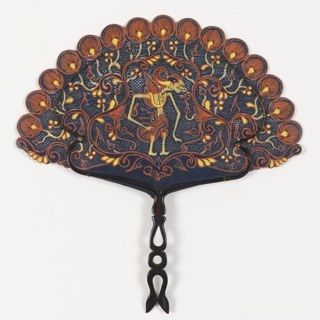 Handscreen in a fan-like shape, of pierced and painted black buffalo hide. Leaf showing a figure in profile resembling a wayang kulit (Indonesian shadow puppet) surrounded by floriate scrolls and peacock feathers. Back buffalo horn handle, carved and pierced with long, undulating frame tied to leaf.