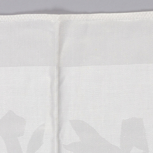 White with an abstract, branch like pattern in a center panel with wide borders.