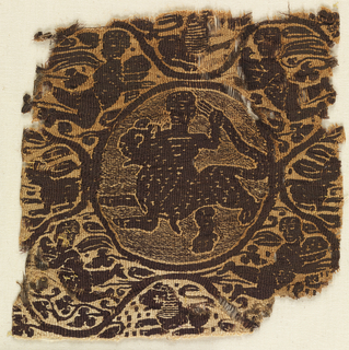 Fragment of a tapestry-woven square.  Monochrome type, dark purple-brown wool and undyed linen.  In a medallion in the center, a figure stands astride a spotted feline, holding its tail.  A serpentine border from which spring leaves of different shapes surrounds the figure.  The four corner spandrels contain Nereids or Victories with cloaks spread out behind them. The upper two are affronted, the lower two addorsed.  At the four sides of the figure appear animals: a hare at each side and a lion at the top and bottom.