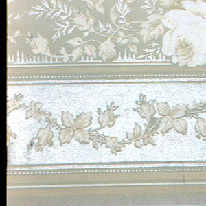 Pattern of roses, leaves and foliage against silhouette of mountain; below band of floral rinceaux. Printed in light green, beige, white, and cream.