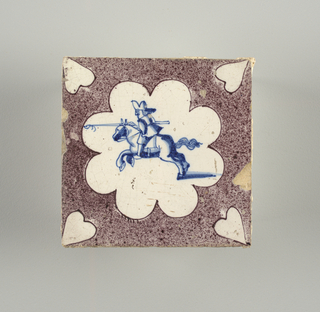 Square tile with cobalt blue figure of mounted lancer charging toward the left, enclosed in an octofoil rosette reserved in white on a ground of stippled manganese violet. Heart shape reserves at the corner.