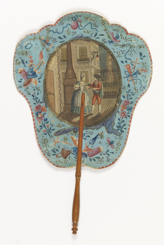 "Handscreen with paper leaf and turned wood handle. Obverse: engraved and hand-colored medallion shows a woman pouring a man a drink outside a building, at night. Reverse: dialogue from the opera ""Les Deux Avares (The Two Misers)"" by André Grétry."