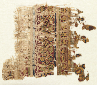 Fragment of a polychrome tapestry weave band incorporating Arabic script, medallion with birds and flowers. Eccentric wefts, slits and double sided. Many wefts are missing.