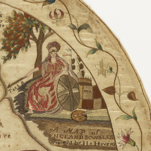 Oval map sampler of England and Wales, with the counties outlined and identified. With a portrait of Britannia in the upper right, and a flowering vine border.