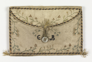 """Silk-covered case ornamented with small flowers and the initials """"C.B."""" in silks and metallic-thread embroidery. Fastens with pearl button and loop. Green silk lining."""