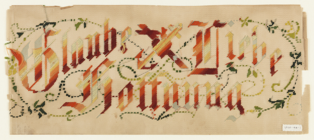 "Panel of perforated white paper embroidered in colored wool with the words: ""Glaube Liebe Hoffnung."" At center is a heart, cross and anchor. Vine and foliage."