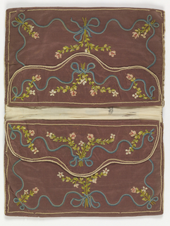 Rectangular letter case in purple silk taffeta, now faded, embroidered with ribbons and colored silks. Inside the double envelope are pouches with flaps, all embroidered in similar floral patterns. Lined with white silk taffeta.