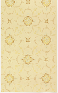 Quatrefoil shapes formed with foliate sprigs, flower at center point, linked to other quatrefoils by scrolling foliage. Four-pointed star or boss in void between motifs. Printed in colors on tan ground.