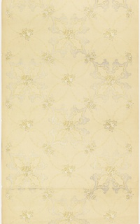 Quatrefoil motif composed of vining foliage with floral center, alternating with another quatrefoil motif composed of acanthus scrolls, also with floral center. Printed in white and gold mica on tan ground.
