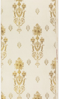 Repeating motif of a floral bouquet in vase, atop two acanthus scrolls that support two more bouquets and a swag, with a wreath below. Smaller floral motifs across background. Printed in metallic gold on white ribbed ground.