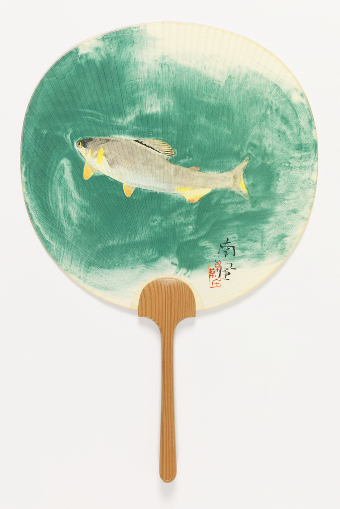 Handscreen with a round silk leaf, loosely painted with a carp in green water. Chinese characters at lower right. Carved wood handle.