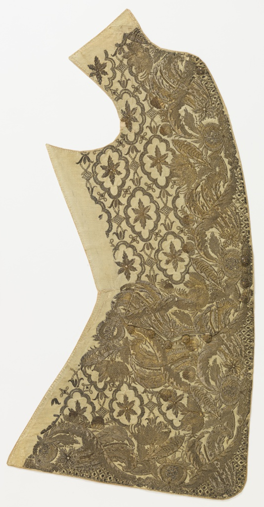 Right front of gentleman's waistcoat embroidered in relief in gold and silver. Border pattern of foliage, flowers and pomegranates.