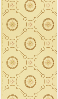 A quatrefoil motif is set within a foliate wreath. The wreaths are contained within a grid or trellis framework. Metallic gold highlights.