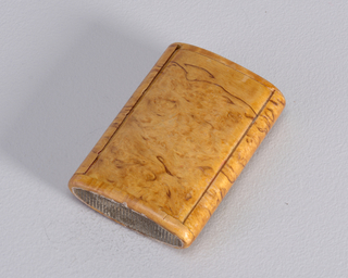 Oblong, eliptical in shape, entire box composed of Burl Wood, 2 sleeves slip together, one sleeve, with striker at bottom, pulls out of other to reveal match compartment inside.