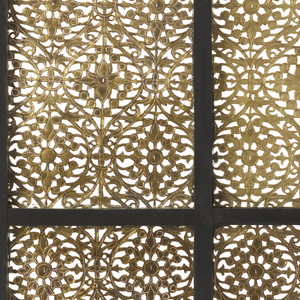 pierced panel, with window frame holding twelve brass panels pierced with matching geometric patterns