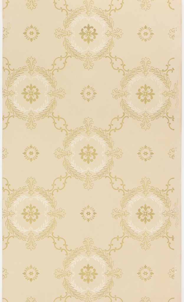 Diaper or trellis pattern containing circular foliate wreaths connected by small scrolls. Printed in brown, metallic gold and white mica on a light tan ground.