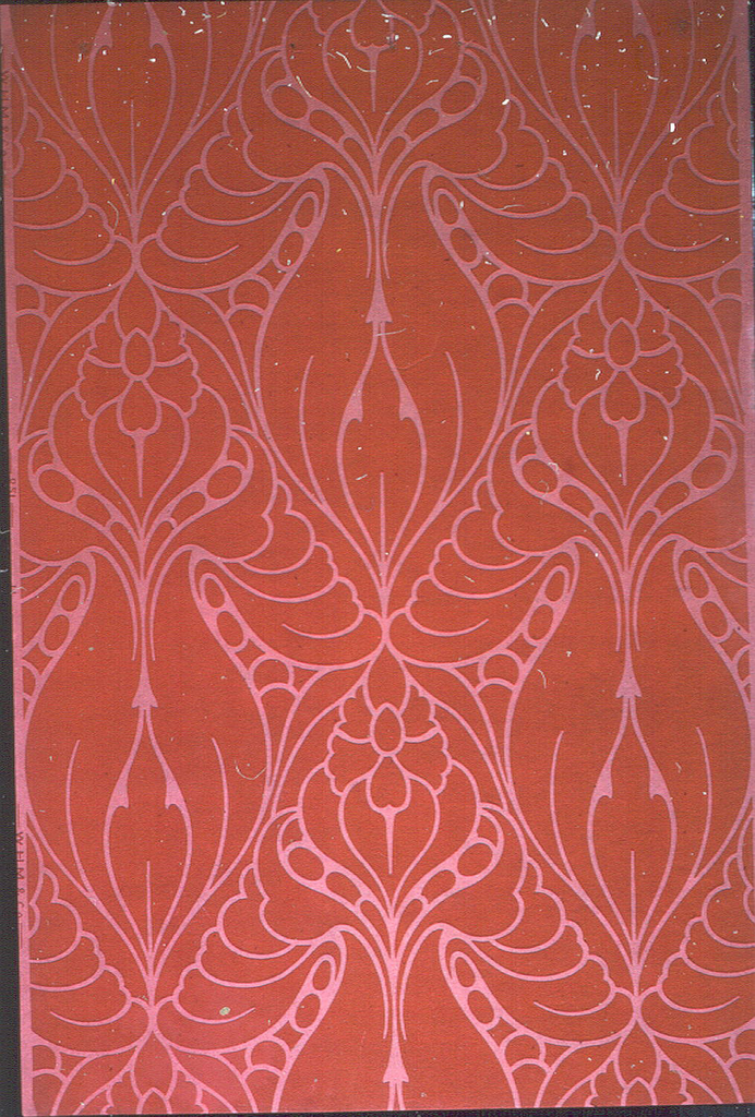 Large-scale stylized floral motifs, forming a diaper-like pattern, printed in red on red.